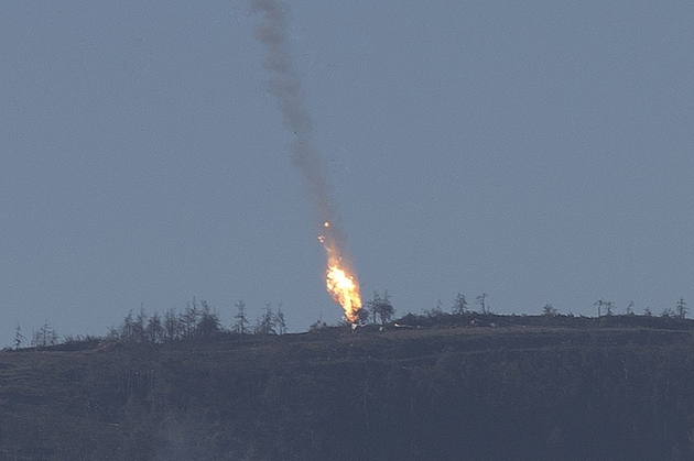Turkey shoots down Russian war plane on Syria border on November 24, 2015. NATO member Turkey on Tuesday shot down a Russian fighter jet on the Syrian border, threatening a major spike in tensions between two key protagonists in the four-year Syria civil war. The Turkish presidency said in a statement that the plane was a Russian Su-24 fighter jet, while Turkish media said one pilot had been captured by rebel forces in in Syria's northwestern Turkmen town of Bayirbucak. The Turkish presidency said in a statement that the plane was a Russian Su-24 fighter jet, while Turkish media said one pilot had been captured by rebel forces in Syria. Two pilots had ejected from the plane and Turkish television pictures showed two white parachutes descending to the ground. Photo by Fatih Aktas/AA/ABACAPRESS.COM